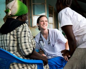 Madison McKinney, a member of Holy Trinity Lutheran Church in Statesville, N.C., talks to villagers during a Mercy Medical Team (MMT) trip to Kenya in June 2014. College students studying for health-care careers may apply for grants that will pay all or most of the cost to take part in an MMT trip. (LCMS/Erik M. Lunsford)
