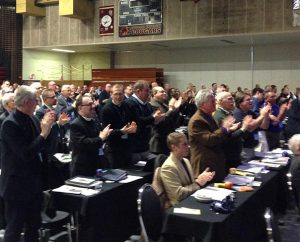 Participants in 2015 LCMS Northern Illinois District convention — March 6-7 at River Forest, Ill. — applaud after LCMS President Rev. Dr. Matthew C. Harrison and Lutheran Church in Norway Acting Bishop Rev. Torkild Masvie sign protocol documents for church fellowship between their two church bodies. (Jon Vieker)