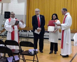 The charter is presented to the congregation during Iglesia Luterana Nueva Vida's Feb. 15 chartering service. From left are the Rev. Pedro Lopez, Nueva Vida's founding pastor; Head Elder Bruce Wasz; Angela Del Pielago, the congregation's president; and LCMS Southeastern District President Rev. Dr. John Denninger. (Iglesia Luterana Nueva Vida)