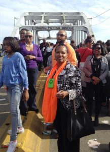 Etta Watts, center, a member of Pilgrim Lutheran Church, Washington, D.C., joins marchers March 8 crossing the Edmund Pettus Bridge in Selma, Ala., during the 50th anniversary of the Voting Rights Movement led by the Rev. Dr. Martin Luther King Jr. (Courtesy of Etta Watts)