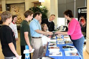 Participants at the 2014 Society of Creation conference in Mequon, Wis., check out resources on creationism. This year's conference is set for July 6-8 in Ann Arbor, Mich. (Gary Locklair)