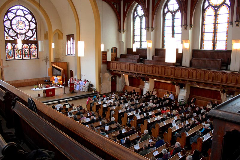 Those gathered inside Lukaskirche (St. Luke's Church) listen to the Rev. Dr. Hans-Jörg Voigt, bishop of the Independent Evangelical Lutheran Church (SELK) in Germany, preach the sermon April 6, Easter Monday. (LCMS Office of International Mission/Rick Steenbock)