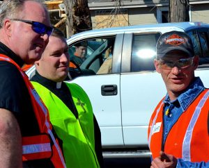 Rochelle, Ill., resident Robert Challand discusses the tornado's aftermath with the Rev. Michael Meyer, disaster response manager for the LCMS Office of National Mission (ONM), and the Rev. Greg Hoffmann, pastor of St. Paul Lutheran Church and School, Rochelle, Ill., April 11. (LCMS/Al Dowbnia)