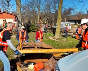 Volunteers work to clear debris in the aftermath of the tornado that struck Northern Illinois April 9. (LCMS/Al Dowbnia)