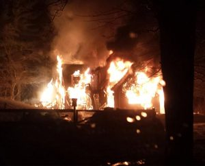 """An early-morning fire engulfs the Taunton, Mass., home of the Rev. Ingo Dutzmann on March 11. The LCMS pastor says """"it's a God thing"""" as an explanation for how all five members of the family escaped unharmed. (Courtesy of the Dutzmann family)"""