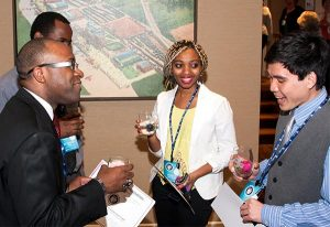 Concordia College Alabama, Selma, students Bruktawit Alemu Shetta (center) and Tri Lan (right) visit with Glenn King Jr. (left), division chair of the college's Business and Integrated Computer Systems, and business professor Dr. Tawonga Moyo at the LCEF National Student Marketing Competition awards dinner, April 10 in St. Louis. (Lutheran Church Extension Fund)