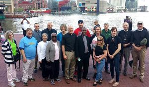 """LCMS Southeastern District (SED) """"prayer walkers"""" pose for a group photo along Baltimore's Inner Harbor. Members of the group — who took part in a city rally and march May 2 — represented nine SED congregations and staff from LINC Baltimore. (Tina Jasion)"""