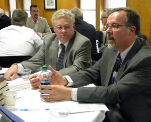 The Rev. Dr. Paul J. Grime (right), dean of Spiritual Formation and the Chapel at Concordia Theological Seminary, Fort Wayne, Ind. offers a comment in small-group discussion during the seminary faculty's joint session with the LCMS Council of Presidents.  At left is Synod Third Vice-President Rev. Daniel Preus. (LCMS/Joe Isenhower Jr.)