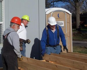 Laborers Mike Crain (from left), Marlow Schaefer and Dave Rohlf begin framing for the new Haskell LIGHT Campus Ministry Center in Lawrence, Kansas.  Lutheran Indian Ministries is participating in Lutheran Church Extension Fund's Laborers For Christ to build the center that will serve students at the Haskell Indian Nations University. (Lutheran Church Extension Fund)