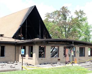 """The 59-year-old building of Grace Lutheran Church in Vestal, N.Y., is declared a """"total loss"""" after a May 18 storm-related fire. (Doug Fett)"""