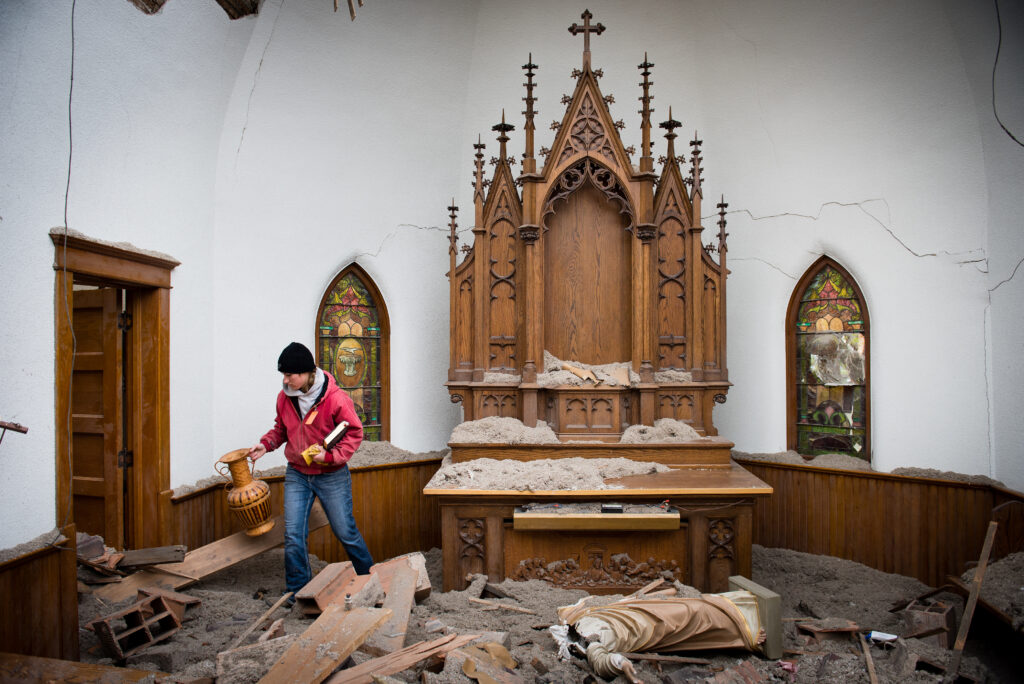 Church member Kera Kaufman tries to salvage items at the damaged altar of Zion Lutheran Church on Monday, May 11, 2015, in Delmont, S.D. A tornado swept through the area on May 10 and destroyed the church along with nearby homes. (LCMS Communications/Erik M. Lunsford)
