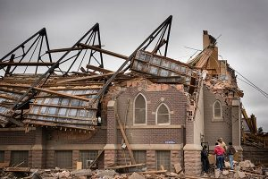 Zion Lutheran Church in Delmont, S.D., is demolished after an EF2 tornado roars through the town May 10, taking off the roof of the church but leaving Sunday-school children and teachers huddled in the basement unharmed. (LCMS/Erik M. Lunsford)