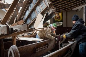 Church members work to salvage cherished items from Zion Lutheran Church on May 11, 2015, in Delmont, S.D. A tornado swept through the area on Sunday and destroyed the church along with nearby buildings. (LCMS/Erik M. Lunsford)