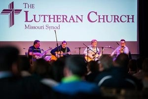 LCMS President Matthew C. Harrison (left) joins the band 'Old School' for a concert at the Stadthaus on Saturday, May 2, 2015, in Wittenberg, Germany. Band members (L-R) the Rev. Russell Tkac, pastor at Peace Lutheran Church, Waterford, Mich., Rob Bourassa of Wyandotte, Mich., and Ross Holmes, who grew up attending Christ Lutheran Church in Fort Worth, Texas, and who currently resides in Nashville, Tenn, join President Harrison. The band 'Lost and Found' also played at the concert following 'Old School.' (LCMS/Erik M. Lunsford)