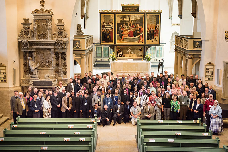Participants — representing 23 million Lutherans in 41 countries — at the International Conference on Confessional Leadership in the 21st Century, May 6-7 in Wittenberg, Germany, pose for a group photo in the historic Town and Parish Church of St. Mary's. (LCMS/Erik M. Lunsford)