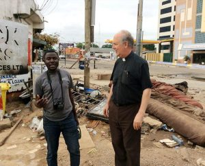 The Rev. Dr. David Erber, LCMS area director for West and Central Africa, (right), visits the site of a flood and explosion in Accra, Ghana, with Justice Oman, director of Lutheran Hour Ministries' Ghana office. (Evangelical Lutheran Church of Ghana/Jacob Fynn)