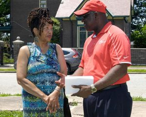 College Hill resident and community leader Carol Crenshaw chats with Fred Kimbrough, Lutheran Housing Support director of Projects and Lending, after the College Hill Peace and Praise Walk June 6. (James H. Heine)
