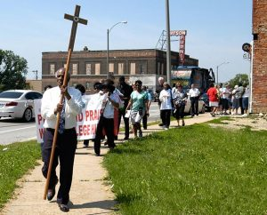 The Rev. Edward Watson, pastor emeritus of St. Paul Lutheran Church, College Hill, leads one of two groups participating in Lutheran Housing Support's Peace and Praise Walk in the College Hill community June 6. (James H. Heine)