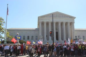 Crowds gather in front of the Supreme Court on April 28, 2015, as justices hear arguments about same-sex marriage. (Religion News Service/Adelle M. Banks)