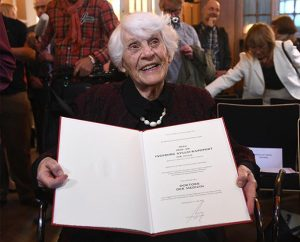 Retired German neonatologist Ingeborg Syllm-Rapoport, 102, poses with her doctoral certificate at the UKE hospital in Hamburg on June 9, 2015. From 1937 until 1938 Syllm-Rapoport studied medicine in Hamburg, but the admission to her oral exam was denied by the Nazi authorities due to her Jewish origin. Syllm-Rapoport took her oral exam and passed it successfully on May 20, 2015 — some 77 years later. (Courtesy of REUTERS/Fabian Bimmer)