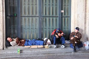 Homeless men sleep just outside of St. Peter's Square at the Vatican on Nov. 13, 2014. (Religion News Service/Josephine McKenna)