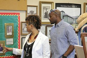 """Kalonji Gilchrist, right, who played Rosa Young's father in """"The First Rosa,"""" and a friend tour the Dr. Rosa J. Young Historical Museum at Concordia College Alabama in Selma, Ala. (Meredith Jackson)"""