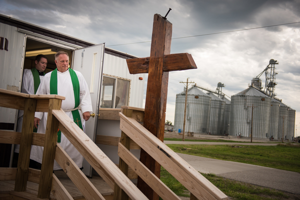 The Rev. Terry Makelin, pastor of St. John Lutheran Church, and the Rev. Michael Meyer, manager of LCMS Disaster Response, descend the stairs before the Day of Supplication and Prayer service in the temporary church office of St. John Lutheran Church on Tuesday, June 16, 2015, in Pilger, Neb. A year ago, almost to the hour, EF-4 twin tornadoes destroyed the church along with the majority of Pilger. LCMS Communications/Erik M. Lunsford