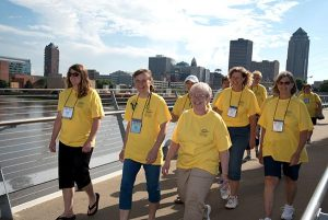 "More than 1,300 walkers join the ""Mission in Motion"" pledge walk through the streets of Des Moines during the 2015 LWML convention. (Kris Bueltmann)"