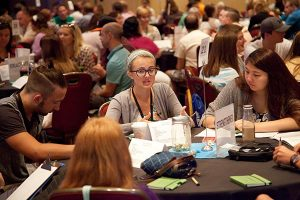 Maddie Upchurch, a Lutheran Youth Fellowship executive board member, and other youth-track participants at NATIONAL 15 reflect during group discussion on the adults in their congregations who have encouraged them in their faith lives. (Seth Hinz)