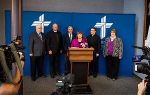 Carol Tobias, president of National Right to Life, speaks at a July 16 press conference with fellow members of the LCMS Sanctity of Life Committee at the LCMS International Center. With her, from left, are the Rev. Dr. Kevin Voss, Concordia Bioethics Institute director; the Rev. Dr. Jonathan Lange, pastor of Our Savior Lutheran Church, Evanston, Wyo.; the Rev. Dr. James Lamb, Lutherans For Life executive director; the Rev. Christopher Esget, pastor of Immanuel Lutheran Church, Alexandria, Va.; and Tracy Quaethem, project coordinator for LCMS Life Ministry. (LCMS/Erik M. Lunsford)