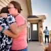 Mindy Kaufman and Waunita Watt (facing camera) hug during the grand opening of the Iowa Life Care (LC) Clinic on Saturday, Aug. 15, 2015, in Creston, Iowa. The clinic is a former Planned Parenthood facility. LCMS Communications/Erik M. Lunsford