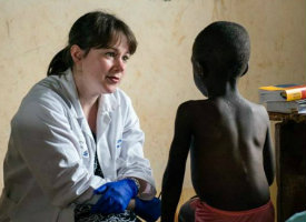 A doctor treating a young patient on a clinical trip in Kenya