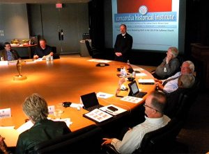 The Rev. Dr. Daniel N. Harmelink, standing, executive director of Concordia Historical Institute, tells members of the LCMS Board of Directors about the work of the institute during the Board's Aug. 21-22 meeting in St. Louis. (LCMS/Joe Isenhower Jr.)