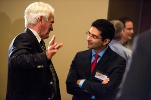 """The Rev. Dr. John W. Kleinig (left), professor emeritus at Luther College, Adelaide, SA, Australia, chats with fellow speaker Sherif Girgis during the DOXOLOGY event """"Finding Our Voice,"""" Aug. 12 at Saint Louis University, St. Louis. (LCMS/Erik M. Lunsford)"""