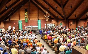 """Youth, chaperones and church workers attend the opening Divine Service for the July 28-31 Higher Things conference at Concordia University, Nebraska in Seward under the theme """"Te Deum."""" (Higher Things/Ann Osburn)"""