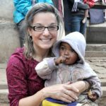 Dr. Maggie Karner holds a child during a 2010 Mercy Medical Team visit to Madagascar. Karner, director of LCMS Life and Health Ministries for 12 years, died Sept. 25 from brain cancer. (LCMS Health Ministry)