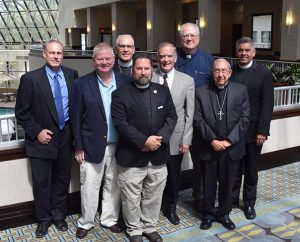 Participants in the Sept. 9-10 consultation between leaders of the LCMS and the North American Lutheran Church are, from left, the Rev. Dr. Joel Lehenbauer (LCMS), the Rev. John Pless (LCMS), the Rev. (Bishop) John Bradosky (NALC), the Rev. Dr. Albert Collver III (LCMS), the Rev. Mark Chavez (NALC), the Rev. Larry Vogel (LCMS), the Rev. Paull Spring (NALC) and the Rev. Dr. David Wendel (NALC). (Courtesy of Albert Collver III)