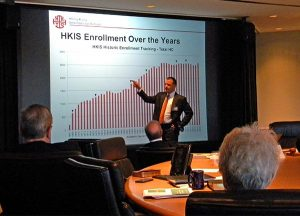 Alan Runge, head of school at Hong Kong International School, reports on the growth in enrollment since the school first opened in 1966. (LCMS/Megan K. Mertz)