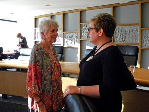 Board member Lois Peacock, left, talks with Karin Semler, executive director of the Asia Lutheran Education Association, during a break on Oct. 16. (LCMS/Megan K. Mertz)