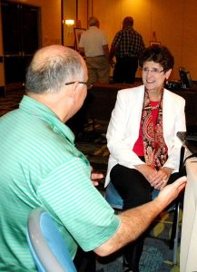 """Dr. Beverly Yahnke talks to a conference-goer after her presentation on """"Child-size Trauma."""" Yahnke, executive director for Christian Counsel with DOXOLOGY: The Lutheran Center for Spiritual Care and Counsel, said staying with a child during a disaster is important. Tell the child you're there to help, she said, and point out the other helpers, such as police officers and firemen. (LCMS/Paula Schlueter Ross)"""