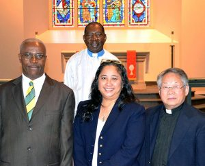 Among the eight Ethnic Immigrant Institute of Theology (EIIT) students receiving calls during a special chapel service Oct. 23 at Concordia Seminary, St. Louis, are, from left, Saint-Luc Charelus, Deaconess Norma Polk and Chong Toua Vang. Also pictured is EIIT Director Rev. Dr. John Loum. (Concordia Seminary)