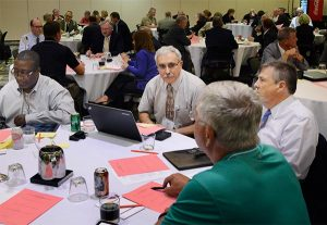 Herman Strozier (left), business manager for the LCMS South Wisconsin District; the Rev. Nabil Nour (center), LCMS fifth vice-president; the Rev. Timothy Yeadon (right), president of the New England District; and Scott Ernst (foreground), treasurer of the Iowa District West, engage in a table discussion during the 2015 LCMS Fiscal Conference Sept. 22. Conference participants engaged in small-group discussions to address priority stewardship and related issues. (LCMS/Roger Drinnon)