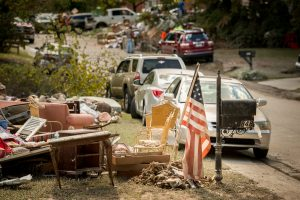 Residents pile flood-damaged debris in front of their homes in a neighborhood on Thursday, Oct. 8, 2015, in Columbia, S.C. LCMS Communications/Erik M. Lunsford