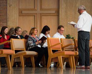 Dr. John D. Eckrich, founder of Grace Place Ministries, leads a prayer service at the Oct. 6-10, 2014, Grace Place retreat for deaconesses in St. Louis. (LCMS/Erik M. Lunsford)