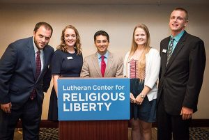"""The four """"Free to be Faithful"""" essay winners pause for a picture with Sherif Girgis (center) after he addressed the recent Lutheran Center for Religious Liberty gathering in Washington, D.C., which focused on the theme """"Let's Talk Marriage, Life and Religious Liberty."""" The ambassadors are, from left, Joshua Lacey, Claire Houser, Bethany Glock and Isaiah Armbrecht. (LCMS/Erik M. Lunsford)"""