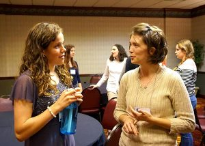 Rebekah Anderson, left, a high school student from St. Paul Park, Minn., talks with Cassandra Wilcoxen, a graduate student at the University of Illinois at Urbana-Champaign, during a gathering for young adults at the 2015 Lutherans For Life National Conference. (LCMS/Megan K. Mertz)