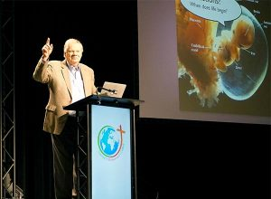 Dr. David Menton, speaker for Answers in Genesis and associate professor emeritus of anatomy at Washington University School of Medicine, St. Louis, gives an up-close look at the development of a child in the womb during his presentation at the 2015 Lutherans For Life National Conference. (LCMS/Megan K. Mertz)