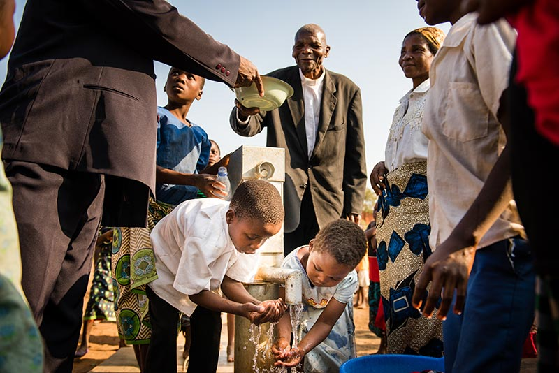 Church and community members enjoy clean water at the other well in Chingale, Malawi. (LCMS/Erik M. Lunsford)
