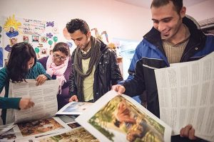 Iranian refugees pick out posters from Concordia Publishing House following a Bible study on Friday, Nov. 13, 2015, near the Evangelisch-Lutherische St. Trinitatisgemeinde, a SELK Lutheran church in Leipzig, Germany. (LCMS/Erik M. Lunsford)