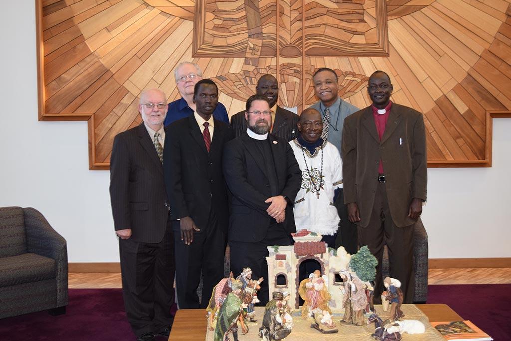 Pictured (left to right back): Dr. Curtis Peters, John Ater Deng, Rev. Larry Vogel, Abraham, Rev. Dr. Roosevelt Gray. Pictured (left to right front): Rev. Dr. Albert Collver, Dr. John Loum, Bishop Elijah Arok.